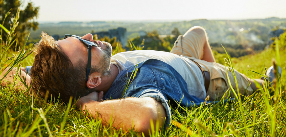 Man on Grass | Sermorelin Therapy: A Solution to HGH Restoration | Victory Men's Health